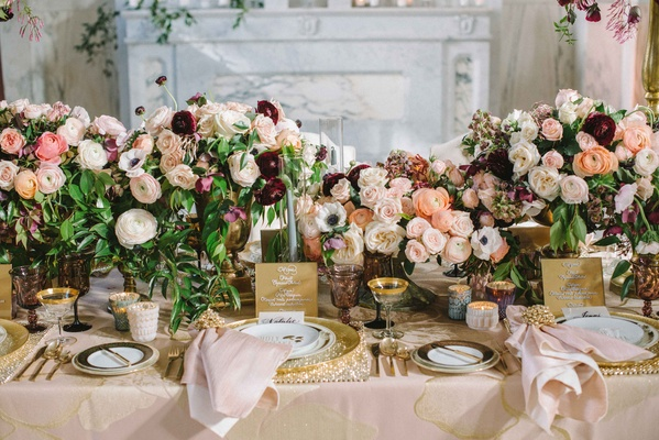 ranunculus centerpieces in ivory, blush, maroon, eggplant