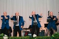 Blue Motown-inspired blazers on father of bride and her uncles for surprise wedding reception song