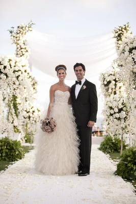 Monique Lhuillier bridal gown and classic tuxedo