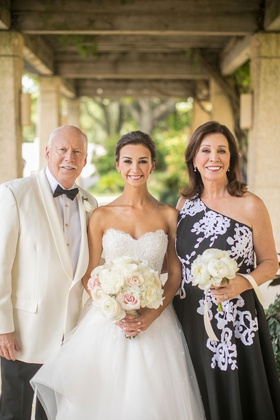 wedding portrait bride in strapless gown mother of bride mob gown one shoulder father tuxedo white