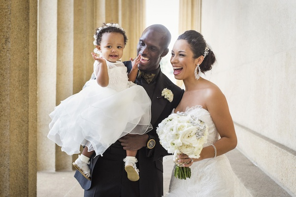 Tennessee Titan with his daughter and bride in a Mark Zunino dress at wedding
