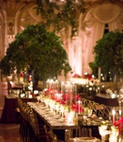 wedding reception tall tree centerpieces long mirror table taper candle candlelight gold chairs