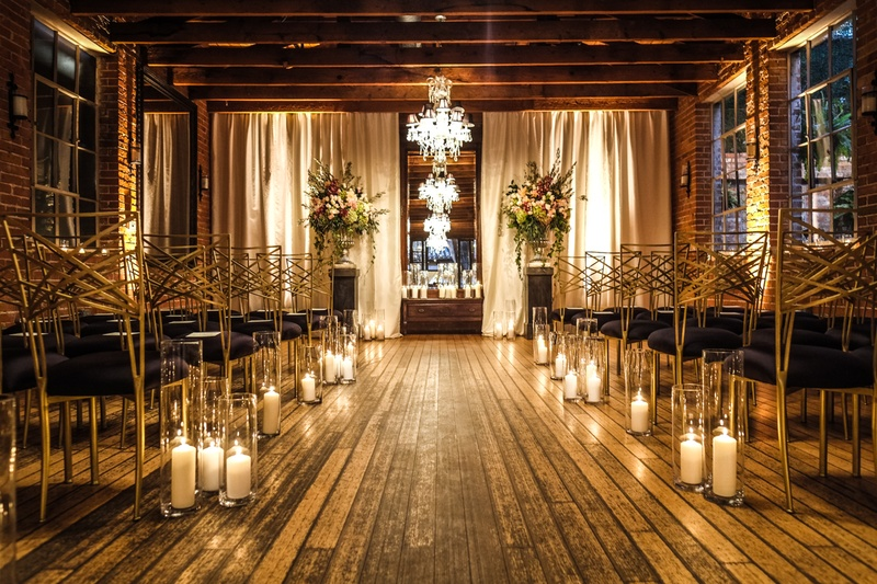 carondelet house wedding ceremony hardwood floors wood ceilings candles black and gold