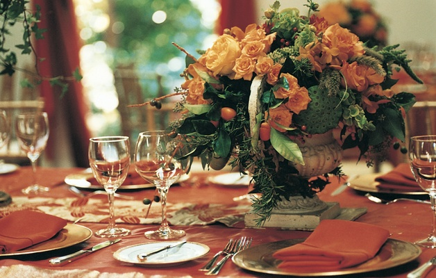 Wedding reception with orange flowers and decorations