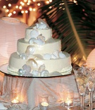 Seashell decorations on beach wedding cake