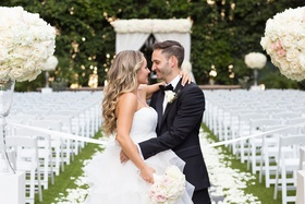 groom in lanvin, bride in reem acra embrace, look into each other's eyes classic outdoor ceremony