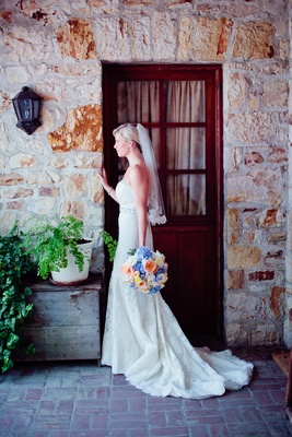 Bride wearing Anne Barge dress and lace veil