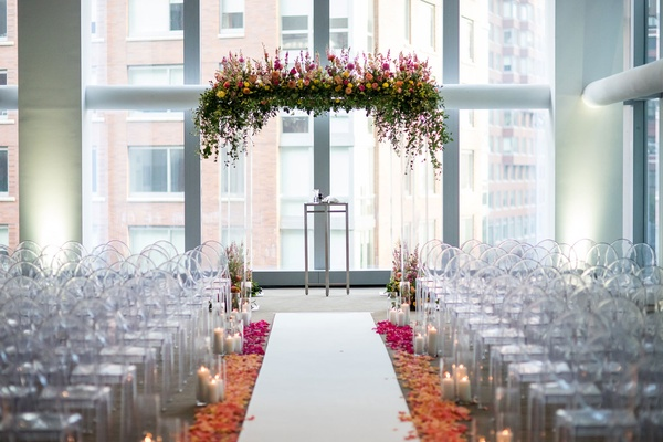 Indoor hotel wedding ceremony white aisle ombre flower petal aisle lucite chuppah with flowers top