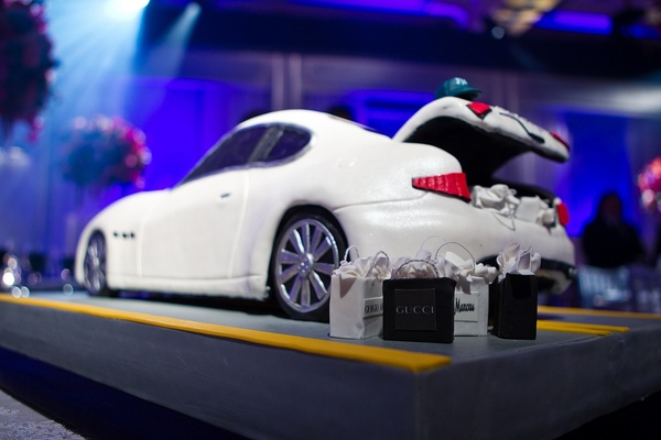 White Maserati cake with edible shopping bags