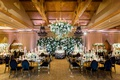 george springer astros wedding ballroom black gold chairs flower wall and flower chandelier
