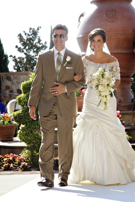 Woman In Fit And Flare Wedding Dress With Man Brown Suit