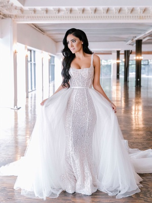 bride with long black hair soft hollywood waves sparkle form fitting gown tulle overskirt train