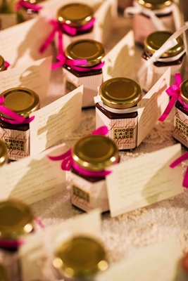 Wedding favor jar of chocolate sauce with tag
