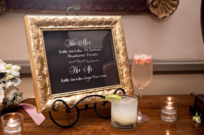 orant gold frame, signature drink menu, wedding cocktail hour