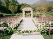 White aisle runner lined with ivory flowers in Montecito