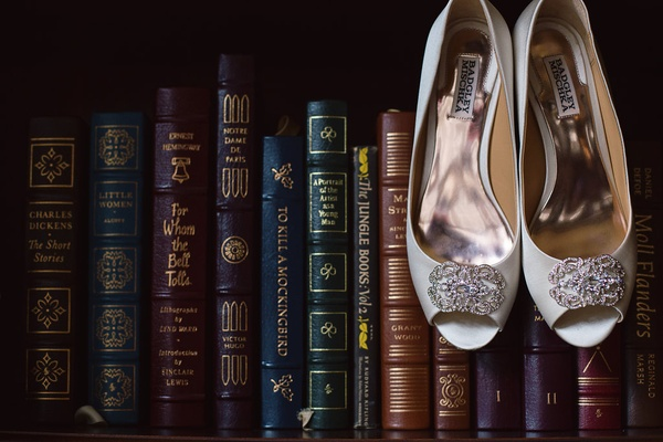 pair heels displayed books shelf badgley mischka vintage library art modern white