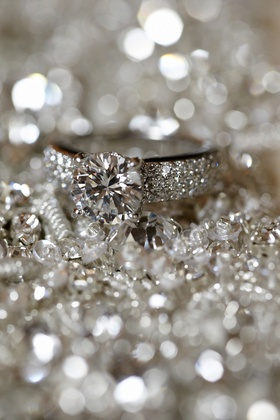 Ring with round-cut diamond and thick jeweled band