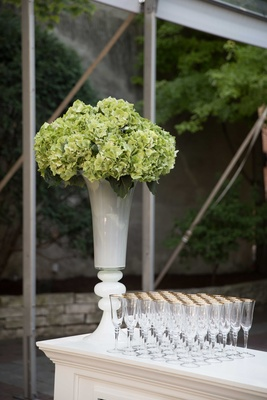 green flower arrangement, southern inspired wedding champagne glasses bar