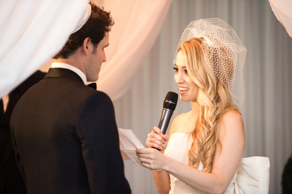 bride reading vows groom microphone chicago wedding ceremony modern details birdcage veil love