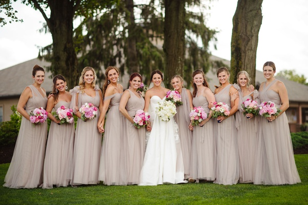 Bride in strapless legends romona keveza wedding dress bridesmaids taupe dresses mismatch necklines