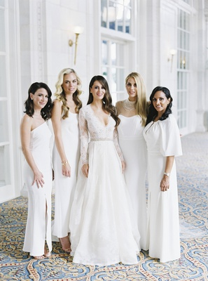 bride in monique lhuillier lace long sleeve a-line gown, bridesmaids in mismatched white dresses