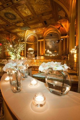 Wedding ceremony at the Terrace Room of The Plaza with white orchids and candles