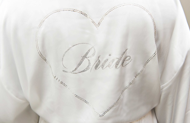 White silky robe with silver heart and bride written on inside bride robe