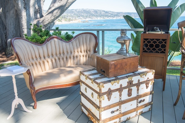Oceanfront wedding with vintage furnishings at outdoor lounge