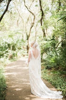 bride in alon livne lace dress with v-back and fingertip veil