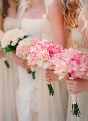 Bridesmaids hold rose bouquets