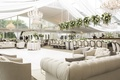 champagne hued lounge space around dance floor wedding reception tan comfy floral chandeliers