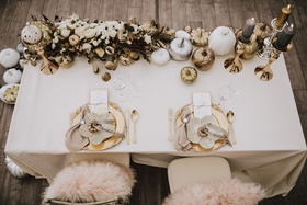 Wedding reception sweetheart table gold pumpkin white pumpkin charcoal candle on gold candlestick