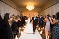bride in romona keveza a-line gown plunging neckline with groom recessional