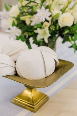 Wedding ceremony jewish wedding entry table yarmulkes ivory on gold footed stand