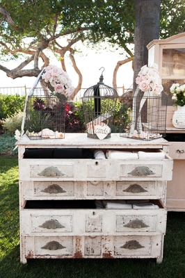 Floral birdcages on top of vintage dresser