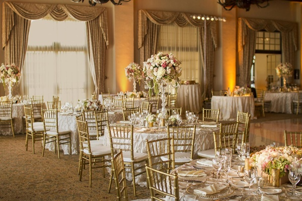 Round tables with gold chairs and accents
