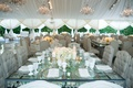 Tented wedding reception square glass table with crystals in between layers tufted beige chairs