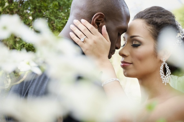 Bride with Jason McCourty wears diamond dangle earrings, bracelet, and sparkling headband