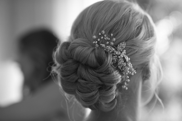 Black and white photo of braided bun hairstyle