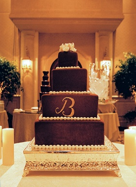 Four layer brown wedding cake with pearl beading detail