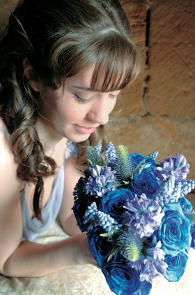 Bridesmaid holding all-blue bouquet with rare flowers