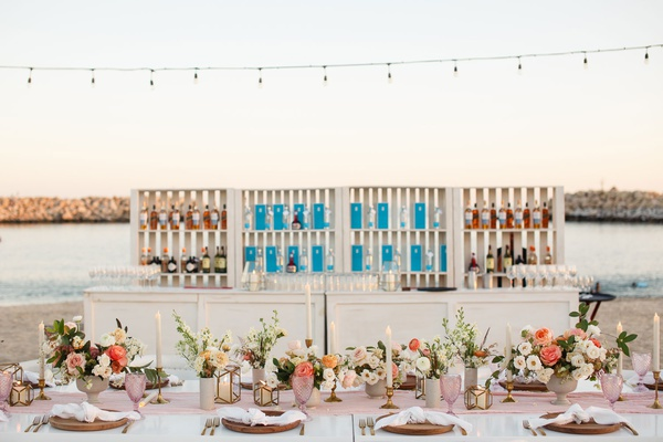 bar set up on the beach at destination wedding in cabo san lucas