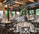 the foundry at puritan mill wedding, brick reception space, vineyard chairs, rustic light fixtures