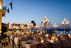 courtyard reception on greek coast, candelabra lantern