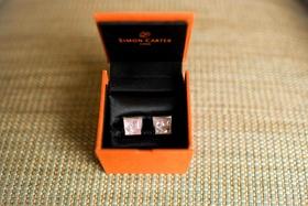 Simon Carter pink cuff links in orange box