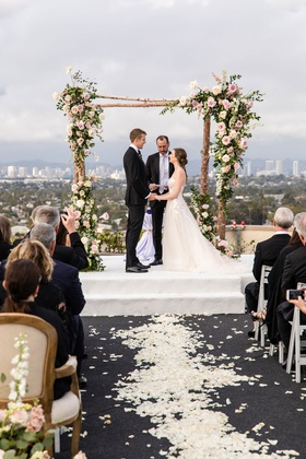 rooftop wedding ceremony los angeles city view rustic birch bark arch pink flowers greenery