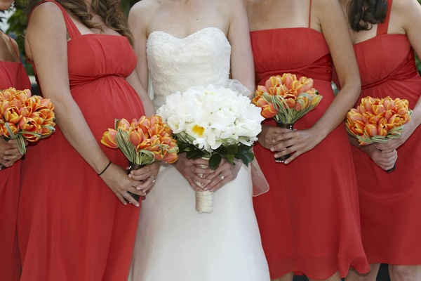 Classic wedding with pops of citrus in chicago illinois inside orange tulip bridesmaid flowers and white bridal bouquet mightylinksfo