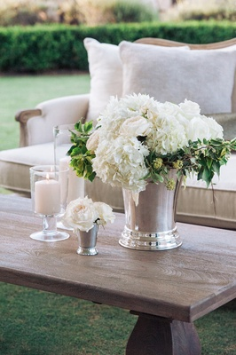 White rose and hydrangea centerpiece on wood coffee table