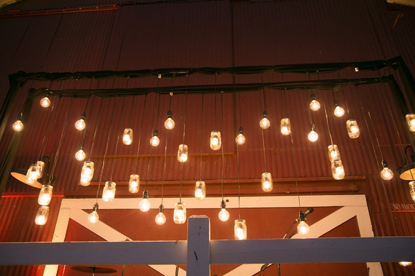 Hanging barn reception lightbulbs in mason jars