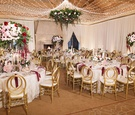 indoor reception space ivory red blush gold hues floral chandelier pelican hill ball room wedding